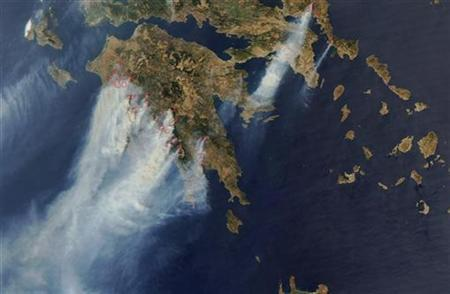 Smoke is seen rising as forest fires sweep through Greece in this handout satellite photo from NASA released on August 26, 2007. Greece's huge forest fires have been blamed by some on global warming, but satellite images of smoke plumes drifting as far as Africa prompt the question: are forests a major source of greenhouse gas? REUTERS/NASA/Handout