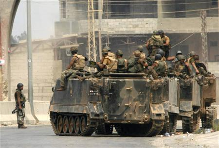 Lebanese soldiers on armoured personnel carriers patrol the outskirts of the Nahr al-Bared refugee camp in north Lebanon September 2, 2007. REUTERS/Omar Ibrahim
