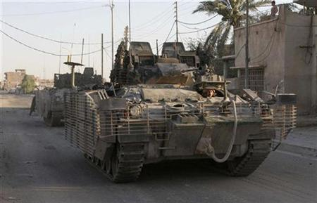 British armoured vehicles roll down a road during patrol after a roadside bomb attack that targeted a British patrol in Basra, 550 km (342 miles) south of Baghdad, June 22, 2007. U.S. plans for handling Iraq after the 2003 invasion were ''fatally flawed,'' a retired British general said, adding that the U.S. administration had refused to listen to British concerns about postwar planning. REUTERS/Atef Hassan