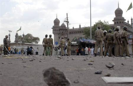 File photo of policemen on guard at the site of a blast in front of Mecca Masjid, the main mosque in Hyderabad, May 18, 2007. REUTERS/Krishnendu Halder/Files