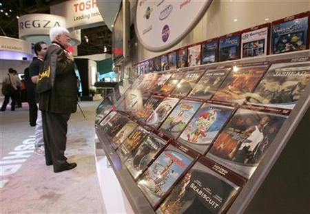 Movies in HD-DVD format are displayed at a Toshiba booth during the 2007 International Consumer Electronics Show (CES) in Las Vegas, Nevada, January 8, 2007.Hollywood studios are becoming deeply divided over which high-definition technology will replace the DVD, increasing prospects that it will be years before next-generation players become standard equipment in U.S. households. REUTERS/Steve Marcus