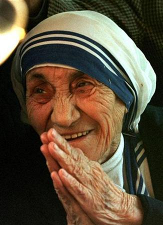 Mother Teresa smiles in this undated file photo from Italy. Letters written by Mother Teresa which reveal she sometimes doubted God surprised and then inspired many among her order, her successor said ahead of Wednesday's 10th anniversary of the ethnic Albanian nun's death. REUTERS/Stringer