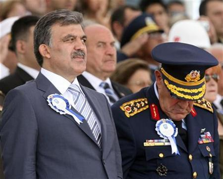 Turkey's new President Abdullah Gul, accompanied by Chief of Staff General Yasar Buyukanit, watches the newly graduated air force cadets during their graduation ceremony at the Air Force war academy in Istanbul, August 31, 2007. Turkey's secular elite, stung by the election of an ex-Islamist president, faces a historic battle over AK Party government plans to jettison a military- inspired constitution and usher in radical reforms. REUTERS/Fatih Saribas