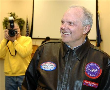 Adventurer Steve Fossett smiles as he meets the media after landing in the Virgin Atlantic GlobalFlyer March 17, 2006, to successfully complete a closed circuit distance record of more than 24,937 miles (40,132 km) during his third around-the-world flight without refueling in the custom-built jet. Fossett, famed for record-breaking solo flights around the world by airplane and balloon, was missing on Tuesday, The Record-Courier newspaper in Nevada reported. REUTERS/Dave Kaup