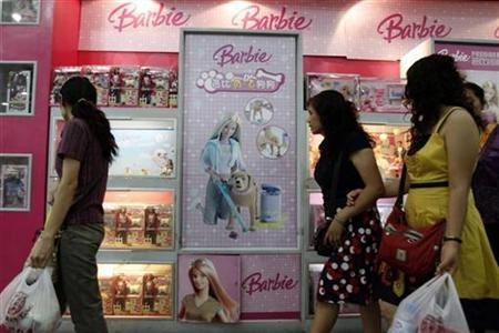 Shoppers look at Barbie & Tanner toys at a store in Beijing August 15, 2007. Toymaker Mattel Inc is to announce a third recall of Chinese-made toys because they may contain too much lead paint, the Associated Press reported on Tuesday. REUTERS/Claro Cortes IV
