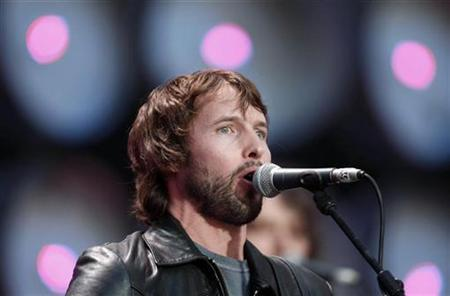 James Blunt performs at at the Live Earth concert at Wembley Stadium, London July 7, 2007. Sanctuary currently manages James Blunt and Elton John and markets merchandise for over 30 big-name acts including Oasis and The Who. REUTERS/Stephen Hird