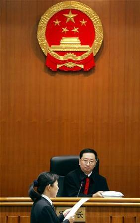 A judge listens to arguments in a Beijing courtroom in a file photo. Music, books and Hollywood films... China can now add testimonies of regret by corrupt officials to its exhaustive list of copyright violations. REUTERS/Guang Niu