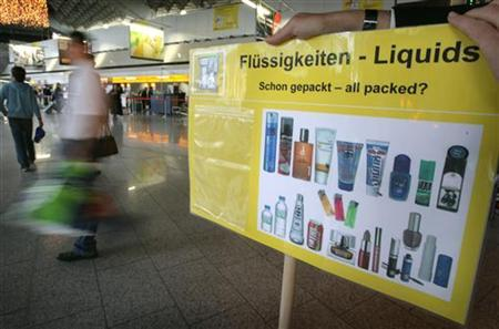 A sign with samples to understand the new security rules for hand luggage are displayed in check-in hall A at the airport in Frankfurt, Germany, November 6, 2006. The European Parliament called on Wednesday for a review of regulations that ban airline passengers from carrying liquids past airport security checkpoints to bring on board. REUTERS/Kai Pfaffenbach