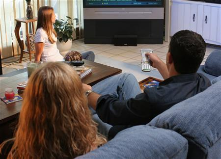 A family watches television in an undated photo. Americans are being subjected to more sex, violence and profane language during the traditional, early-evening ''family hour'' of broadcast television viewing, a U.S. watchdog group said on Wednesday. REUTERS/File
