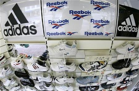 Sport shoes are displayed in this file photo taken on August 3, 2005. Three thieves robbing a sporting goods store in Uruguay spent half an hour waiting on customers before making their getaway with merchandise and the money from the till, police said on Wednesday. REUTERS/Christian Charisius