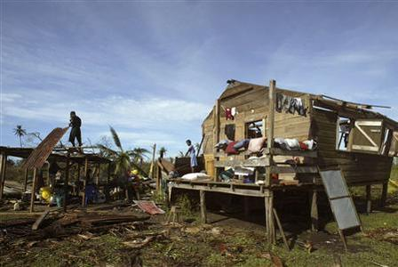 A Miskito Indian man repairs his house, damaged by Hurricane Felix, in the small town of Krukira on the Caribbean coast of Nicaragua, September 6, 2007. REUTERS/Oswaldo Rivas