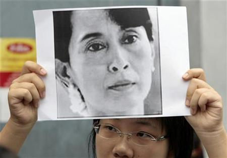 A woman from Myanmar holds a portrait of the country's opposition leader Aung San Suu Kyi outside the Myanmar embassy in Bangkok, Thailand, September 2, 2007. President Bush on Friday demanded the immediate release of Myanmar activists and called on the ruling junta to stop ''assaulting pro-democracy activists. REUTERS/Sukree Sukplang