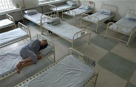 An inmate rests at a hospital which houses and provides treatments to about 100 patients who are suffering from mental disorders, in Hefei, east China's Anhui province July 3, 2007. REUTERS/Jianan Yu