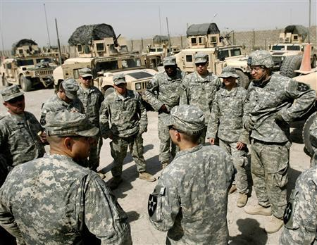 U.S. soldiers attend a meeting before a patrol at Zafraniya neighbourhood, southeast of Baghdad, September 7, 2007. REUTERS/Carlos Barria