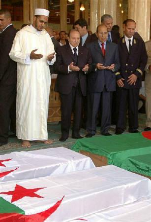 Algeria's President Abdelaziz Bouteflika (2nd L) prays with unidentified officials, in front of the coffins of victims of a bomb attack, at a mosque in Batna, about 450 km east of Algiers, Friday, September 7, 2007. REUTERS/Stringer