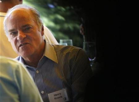 Henry Kravis of Kohlberg Kravis Roberts & Co. talks to a colleague during lunch at the Allen & Co. conference at the Sun Valley Resort in Sun Valley, Idaho July 11, 2007. KKR appears willing to make a concession to the banks financing its $26 billion leveraged buyout of payment processor First Data Corp <FDC.N>, according to a report on Sunday. REUTERS/Rick Wilking (UNITED STATES)