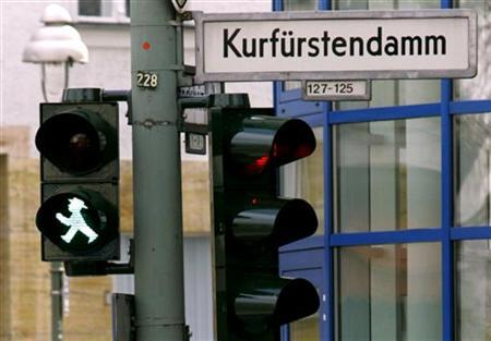 A pedestrian light is pictured in western Berlin April 12, 2005. A town council in Germany has decided the best way of improving road safety is to remove all traffic lights and stop signs downtown. REUTERS/Tobias Schwarz