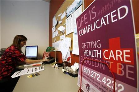 A representative at the non-profit 'Healthcare For All' in Boston, Massachusetts helps a caller with a health insurance question in this January 19, 2007 file photo. The gap between rises in health insurance premiums and wages is at its widest point in six years, a survey said on Tuesday, which experts said puts workers in a perilous position should the economy turn sour. REUTERS/Brian Snyder/Files