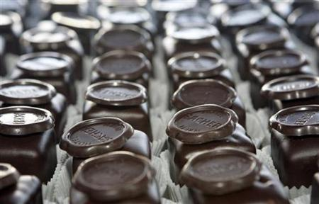 Sachertorte cubes are arranged in Hotel Sacher's cake factory in Vienna March 2, 2007. Resistance is futile. The more we try to fight off a craving for chocolate, the more our desire for it grows, a British researcher said on Tuesday. REUTERS/Herwig Prammer