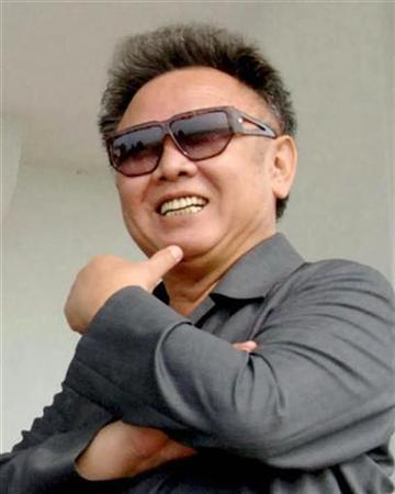 North Korean leader Kim Jong-il smiles as he inspects the Sinam cooperative farm in Ryongchon county in North Korea, in this undated photo released by Korea News Service in Tokyo June 8, 2007. The removal of all nuclear weapons from North Korea next year could pave the way for a summit meeting between U.S. President George W. Bush and the reclusive state's leader, Kim Jong-il, a U.S. envoy said on Wednesday. REUTERS/Korea News Service/Files