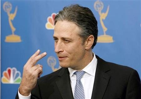 Jon Stewart poses backstage after winning an Emmy for outstanding variety, music or comedy series at the 58th annual Primetime Emmy Awards at the Shrine Auditorium in Los Angeles August 27, 2006. Stewart will host the Academy Awards next February, taking the stage for the second time, the Academy of Motion Picture Arts and Sciences said on Wednesday. REUTERS/Mario Anzuoni