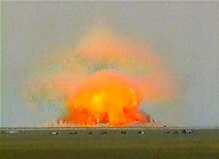 A new ordnance, claimed by the Russian military the world's most powerful non-nuclear bomb, explodes in a giant fireball during a test in this undated television image shown by Russian Channel One television, September 11, 2007. Russia has tested world's most powerful vacuum bomb, which unleashes a destructive shockwave with a power of a nuclear blast and dwarfs the biggest U.S. bomb of a kind, the military said on Tuesday. REUTERS/Reuters TV