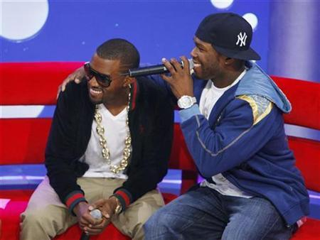 Entertainer Kanye West (L) and Curtis ''50-Cent'' Jackson laugh at a taping of the BET Channel's show ''106th and Park'' on the day that both West and rival 50 Cent release their respective new albums in New York September 11, 2007. West looks set to win the closely watched duel with rival rapper 50 Cent for the No. 1 slot on next week's U.S. pop album chart, according to preliminary sales data issued Wednesday. REUTERS/Lucas Jackson