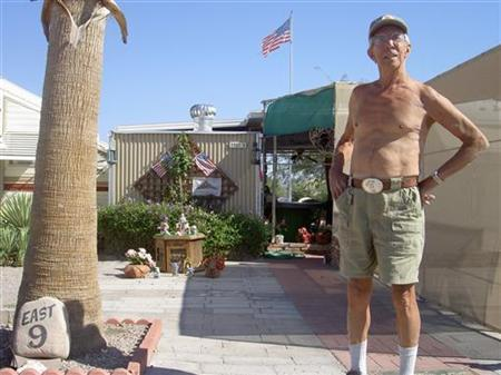 A retiree stands in the sun outside his trailer home in Quartzsite, Arizona, October 31, 2006. Life expectancy in the United States has increased to almost 78 years, the country's highest on record, amid a downturn in deaths from heart disease, cancer and stroke, according to new federal estimates published on Wednesday. REUTERS/Tim Gaynor
