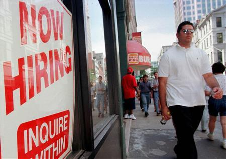 A man walks by a sign advertising a job vacancy in this undated file photo. The number of workers signing up for jobless benefits edged up a smaller-than-expected 4,000 last week, a government report showed on Thursday. REUTERS/ File