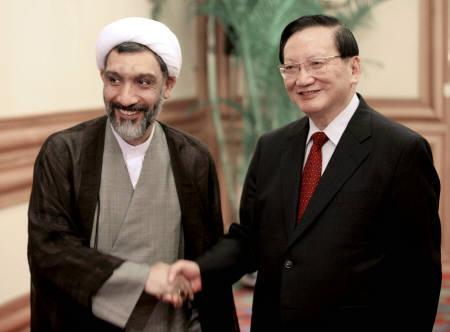 China's State Councillor Tang Jiaxuan (R) shakes hands with visiting Iran's Interior Minister Mostafa Pourmohammadi in Beijing September 14, 2007. REUTERS/China Daily