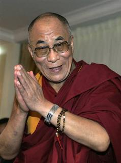 The Dalai Lama gestures during a news conference in Lisbon September 12, 2007. REUTERS/Hugo Correia/Files