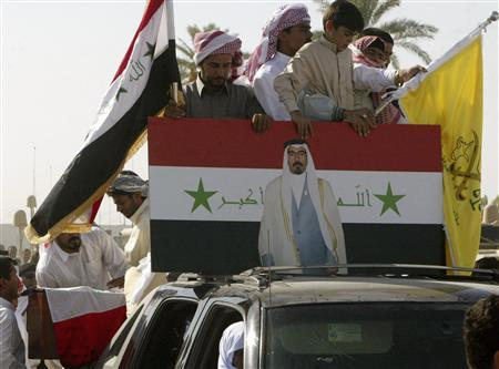 The coffin of Abdul Sattar Abu Risha, a Sunni Arab tribal leader, who was killed by a roadside bomb attack on Thursday, is placed on the back of a truck during a funeral in Ramadi, 100 km (60 miles) west of Baghdad, on September 14, 2007. REUTERS/Stringer