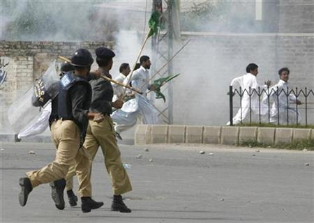 Policemen chase supporters of former prime minister Nawaz Sharif during a pro-Sharif rally in Rawalpindi near Islamabad, September 10, 2007. Sharif was arrested and deported to Saudi Arabia within hours of arriving home from exile, vowing to end the rule of President Pervez Musharraf. REUTERS/Mian Khursheed