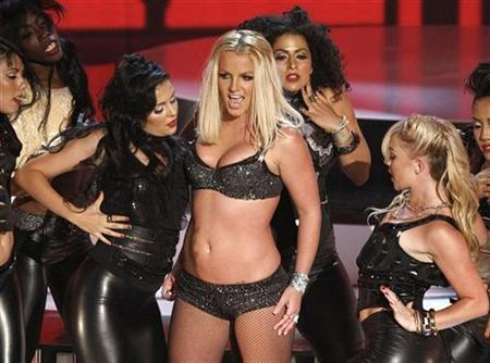 Britney Spears performs at the 2007 MTV Video Music Awards in Las Vegas, September 9, 2007. Britney Spears' new single, ''Gimme More,'' came roaring out of the gates on CHR (contemporary hit radio)/top 40 radio, debuting at No. 25 on Billboard sister publication Radio & Records' format chart for the week ending September 2 and endowing Spears with the second-best start of her career. But that was before MTV's Video Music Awards (VMAs). REUTERS/Robert Galbraith