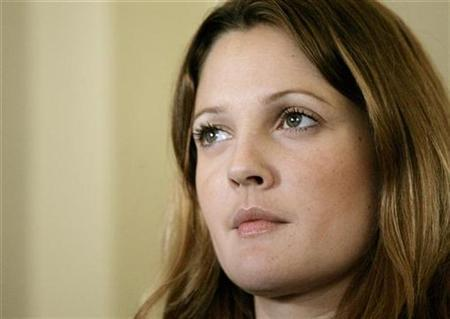 Actress Drew Barrymore listens during a news conference where she was named Ambassador against Hunger for the United Nations World Food Program (WFP), on Captiol Hill in Washington May 10, 2007. Drew Barrymore and Jessica Lange will star in an HBO movie adaptation of ''Grey Gardens,'' the 1975 documentary about Jacqueline Kennedy Onassis' eccentric cousin and aunt. REUTERS/Molly Riley
