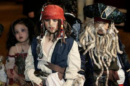 Children dressed as characters from ''Pirates of the Caribbean: At World's End'' pose at a costume event to promote the movie in Tokyo, May 24, 2007. Put a parrot on your shoulder, strap on a peg leg, hit the rum and start bellowing ''Shiver me Timbers'' -- Wednesday is International Talk Like A Pirate Day. REUTERS/Kim Kyung-Hoon