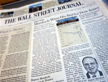 A photograph of the front page of the August 1, 2007 edition of the Wall Street Journal. Rupert Murdoch, whose company has sealed a deal to buy Journal publisher Dow Jones & Co Inc said on Tuesday that he was leaning toward making online Wall Street Journal free, but had made no decision yet. REUTERS/Mike Segar