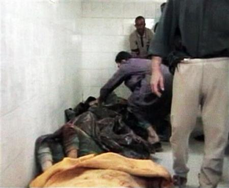 An image taken from footage shot on November 19, 2005 shows bodies in a morgue after an incident in Haditha. The U.S. Marines have dismissed charges against one of the officers accused of dereliction of duty for failing to report accurately the U.S. killing of 24 Iraqi civilians in Haditha in 2005. REUTERS/Reuters TV/File