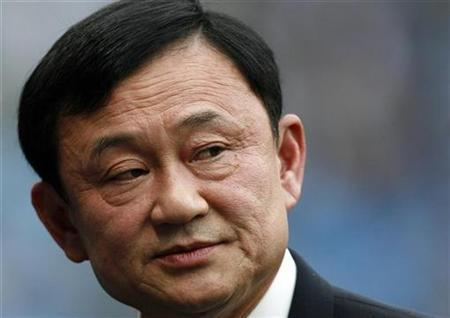Thailand's ousted Prime Minister and Manchester City Chairman Thaksin Shinawatra watches ahead of their English Premier League match against Aston Villa in Manchester, September 16, 2007. REUTERS/Nigel Roddis NO ONLINE/INTERNET USAGE WITHOUT A LICENCE FROM THE FOOTBALL DATA CO LTD. FOR LICENCE ENQUIRIES PLEASE TELEPHONE +44 (0) 207 864 9000.