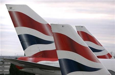 Tail fins of British Airways aeroplanes are seen on the tarmac of London's Heathrow Airport, January 28, 2007. British Airways said on Wednesday it would suspend its daily flight between Detroit and London Heathrow in March, citing the changing nature of the U.S. auto industry. REUTERS/Luke Macgregor
