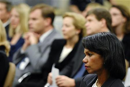 Secretary of State Condoleezza Rice attends a farewell ceremony for outgoing U.S. Attorney General Alberto Gonzales on his last day in the post in Washington September 14, 2007. Rice scolded the U.N.'s atomic watchdog agency on Wednesday over its Iran strategy and called for diplomacy with ''teeth'' to end Tehran's nuclear plans. REUTERS/Jonathan Ernst