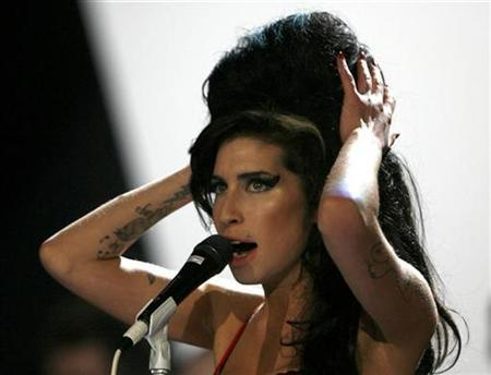 Amy Winehouse performs at the Brit Awards, February 14, 2007. Winehouse won a top prize at the annual Music of Black Origin (MOBO) awards in London on Wednesday. REUTERS/Kieran Doherty