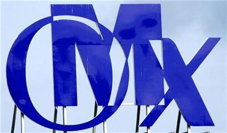 An OMX logo is seen atop a building near their headquarters in Stockholm, August 20, 2007. Two Swedish newspapers reported on Thursday that Nasdaq and state-run Borse Dubai are set to merge and take control of Nordic exchange group OMX. REUTERS/Bob Strong