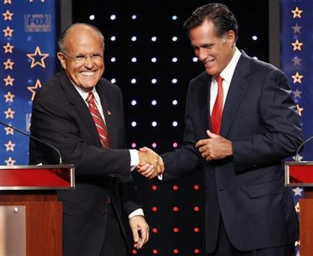 Republican presidential candidates former New York City Mayor Rudy Giuliani (L) and former Massachusetts Governor Mitt Romney shake hands during Fox News Channel Republican Presidential debate, September 5, 2007. Republican presidential candidates are locked in a tight bunch with none emerging as the clear-cut leader. REUTERS/Brian Snyder