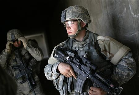 U.S. soldiers of Bravo company of 2nd Battalion, 17th Field Artillery Regiment, search an abandoned building during a patrol in the Zafraniya neighbourhood in the southeast of Baghdad September 20, 2007. REUTERS/Carlos Barria
