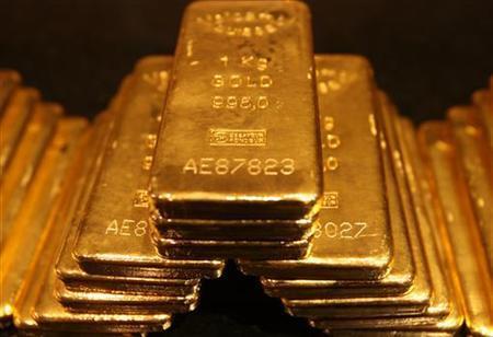 One-kilo gold bars are displayed inside a secured vault in Dubai April 20, 2006. REUTERS/Tamara Abdul Hadi