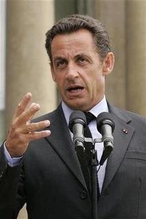 France's President Nicolas Sarkozy speaks during a news conference in the court of the Elysee Palace in Paris in this file photo dated August 20, 2007. France's Socialist party on Friday accused Sarkozy of suffering from ''small man syndrome'', saying this explained why the shorter-than-average president had proclaimed his reforms the biggest in decades. REUTERS/Benoit Tessier