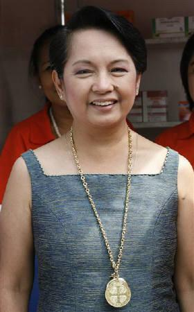 Philippine President Gloria Macapagal Arroyo seen at the Cuneta astrodome in Pasay city, suburban Manila in this September 14, 2007 file photo. Arroyo has suspended a $330 million telecommunications deal with a Chinese firm after it triggered a kickbacks scandal that could rattle her government. REUTERS/Romeo Ranoco