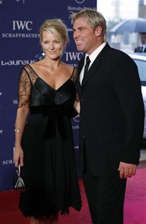 Cricketer Shane Warne and his wife Simone pose as they arrive for the Laureus World Awards ceremony in Barcelona April 2, 2007. REUTERS/Albert Gea