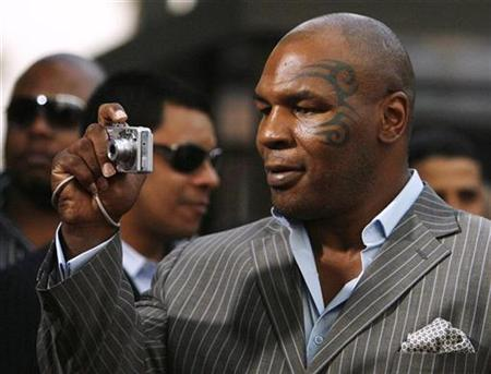 Former heavyweight champion Mike Tyson arrives at the premiere of ''Resurrecting the Champ'' at the Samuel Goldwyn theatre in Beverly Hills, California, August 22, 2007. Tyson pleaded guilty to drug possession and driving under the influence in an Arizona court on Monday. REUTERS/Mario Anzuoni